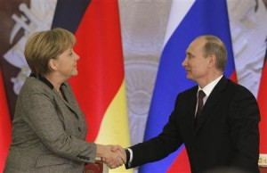 Russian President Putin shakes hands with German Chancellor Merkel after their joint news conference in Moscow's Kremlin