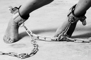 woman-feet-are-cuffed-with-steel-shackles-william-langeveld