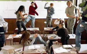 Schoolchildren (14-16) having paper fight in classroom www.telegraph.co.uk