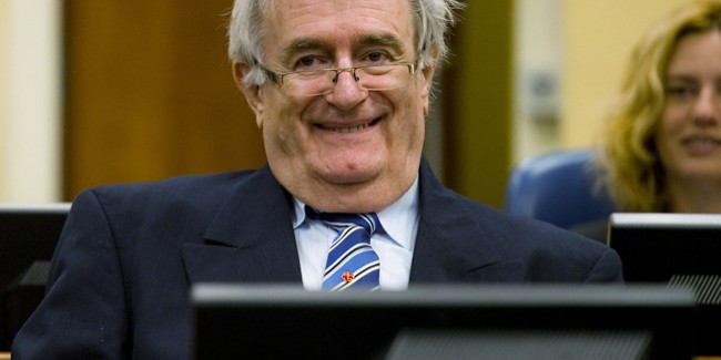 Former Bosnian Serb leader Radovan Karadzic sits in the courtroom on the first day of his defense against war crime charges at the International Criminal Tribunal for the Former Yugoslavia in The Hague October 16, 2012. The Yugoslavia  war crimes tribunal begins trying its last suspect on Tuesday. Karadzic is one of a trio of architects of the Balkan wars brought to trial in The Hague for wars among the successor countries and the peoples of multi-ethnic Yugoslavia between 1991 and 1999, in which well over 100,000 people were killed and millions were displaced. REUTERS/Robin van Lonkhuijsen  (NETHERLANDS - Tags: POLITICS CRIME LAW CONFLICT TPX IMAGES OF THE DAY) - RTR396U0